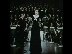 Kate Smith Debuts 'God Bless America' on Armistice Day on TV and Radio throughout America